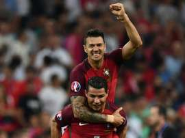 Portugal's Cristiano Ronaldo gives a lift to Fonte as they celebrate beating Poland in their Euro 2016 quarter-final match