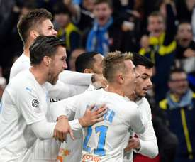 Radonjics late goal pushes Marseille to within five points of PSG. Goal