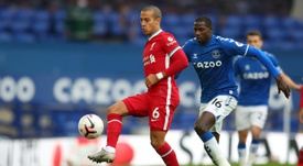 Thiago Alcantara (L) is not yet ready to return to action for Liverpool. AFP