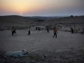 Israeli Bedouin children play football in the village of Abu Tlool. AFP