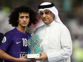 President of the Asian Football Confederation Shaikh Salman bin Ebrahim Al Khalifa (R) presents Al-Ains midfielder Omar Abdulrahman with the man of the match trophy on November 26, 2016