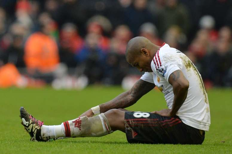 Ashley Young sitting on the pitch. Goal
