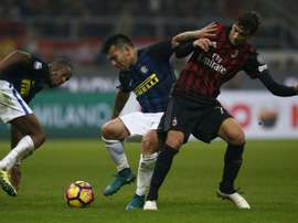 Gary Alexis Medel (C) in action during an Italian league match against AC Milan. AFP