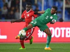 Saifeldin Bakhit (L) playing for Sudan against Nigeria. AFP