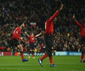 Fellaini celebrates scoring his 91st minute winner at Old Trafford. AFP