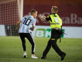 La Liga takes legal action against pitch invader. AFP