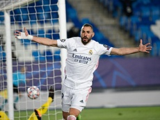 Karim Benzemas brace sent record 13-time winners Real Madrid through. AFP