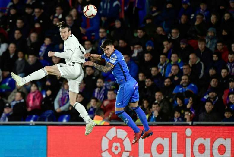 Bale (L) is making it difficult for Real Madrid to sell him this summer. AFP