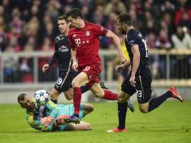 Bayern Munichs Robert Lewandowski (C) grabbed five goals against Wolfsburg last week, two more against Mainz last weekend and claimed a hat-trick in a mid-week win against Dinamo Zagreb in the Champions League