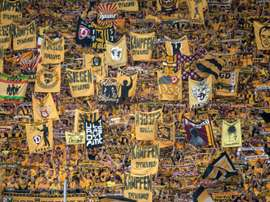 On top of a hefty fine, Dresden must play their next league match in front of 9,000 empty seats. AFP