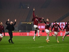 AC Milan are back ahead of Inter after beating Lazio. AFP