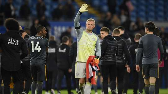 Leicester's Kasper Schmeichel applauds fans after his side's emotional win at Cardiff. AFP