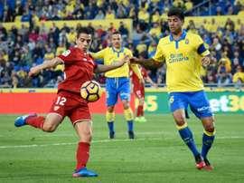 Sevillas forward Wissam Ben Yedder (L) clashes with Las Palmas defender Aythami Artiles