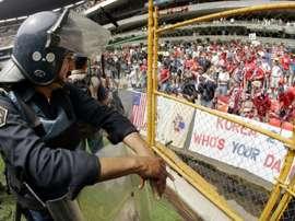 USSF say hostile atmosphere mean USA men's team deserve more money than the women's side. AFP