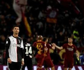 Florenzi, Dzeko keep Roma's Champions League hopes alive
