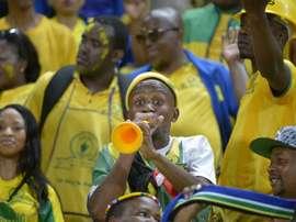 A Mamelodi Sundowns fan blows a vuvuzela prior to the  CAF Champions League final. AFP