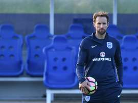 England caretaker manager Gareth Southgate takes a training session at St Georges Park. AFP