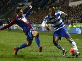 Crystal Palaces midfielder Yohan Cabaye (L) lunges to block a shot from Readings midfielder Jordan Obita during the FA cup sixth round football match at the Madejski stadium in Reading on March 11, 2016
