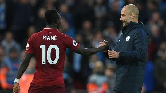 El empate entre Liverpool y City dejó a ambos aún invictos. AFP