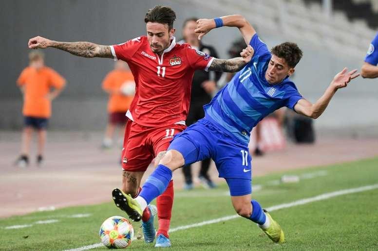 Kostas Tsimikas (R) has joined Liverpool from Olympiakos. AFP