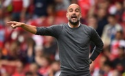 Manchester City boss Pep Guardiola barks out orders to his players. AFP