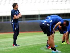 Italy national football team head coach Antonio Conte (L) oversees a training session. AFP