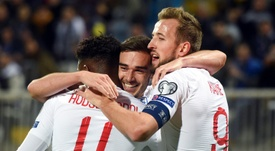 England's Harry Winks (C) celebrates after scoring the opening goal against Kosovo. AFP