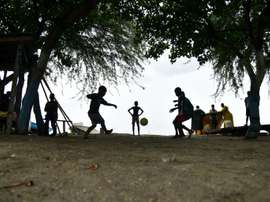 Children play football close to Caira beach in the commune of Leogane, south-west of Port-au-Prince