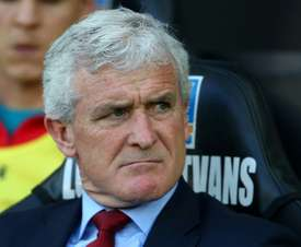 Hughes says his side have been the victims of bad luck this season. AFP