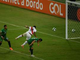 Farfan (c) scored one of Peru's goals v Bolivia. AFP