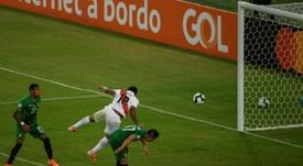 Farfan (c) scored one of Peru's goals v Bolivia. AFP