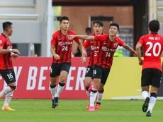 Li Shenglong's double saw Shanghai SIPG beat Sydney FC 2-1 in Doha. AFP