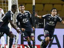 Lyons French defender Rafael Pereira Da Silva celebrates after scoring a goal during the French L1 football match between Monaco (ASM) and Lyon (OL) on October 16, 2015 at the Louis II Stadium in Monaco