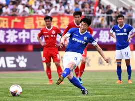 The 44-year-old became the oldest goalscorer in Chinese professional football history. AFP