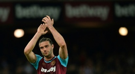 Andy Carroll has had a injury hit time at the Hammers. AFP