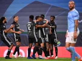 Moussa Dembele scored twice Lyon beat Man City to reach the Champions League semis. AFP