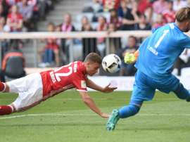 Bayern Munichs midfielder Joshua Kimmich (L) heads the first goal for Munich against Colognes goalkeeper Timo Horn (R) during the German first division Bundesliga football match between FC Bayern Munich and 1 FC Cologne