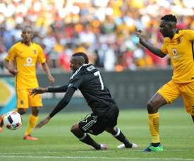 The two deaths occured when Kaizer Chiefs (in yellow) took on Orlando Pirates in Johannesburg. AFP
