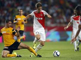 Monaco's Croatian midfielder Mario Pasalic (R) vies with Young Boys' Czech defender Jan Lecjaks (L) during the UEFA Champions League third qualifying round second leg football match on August 4, 2015 at the Louis II Stadium in Monaco