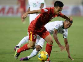 Vietnam's Nguyen Van Quyet (left) fights for the ball with Indonesia's Lestaluh. AFP