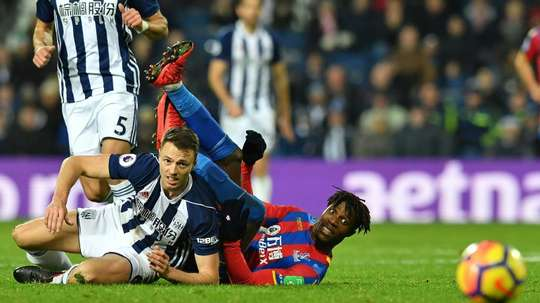Evans pictured playing for West Brom last season. AFP
