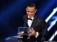 Penang FA and Malaysias midfielder Mohammed Faiz Subri holds his trophy. AFP