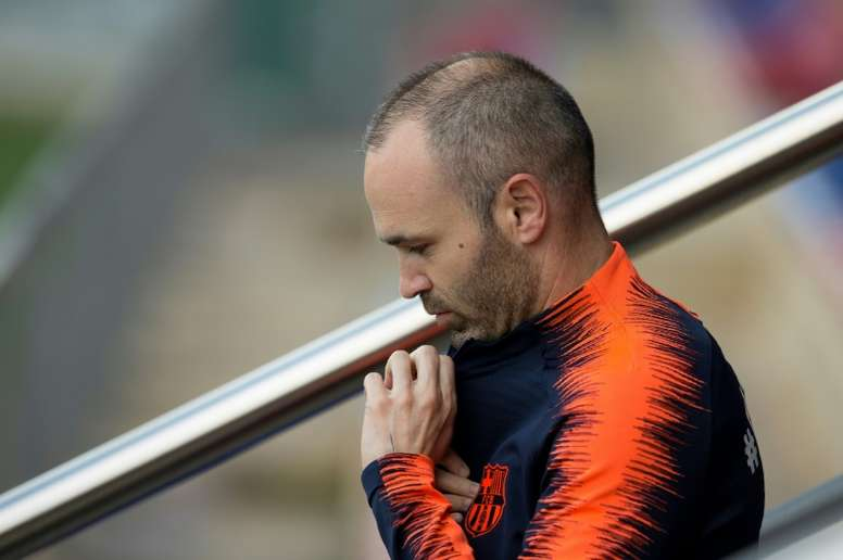 Iniesta will leave Barcelona at the end of the season. AFP