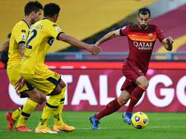 Roma want to keep in form Henrikh Mkhitaryan (R). AFP