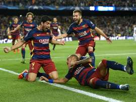 Barcelonas Luis Suarez (C-L) celebrates scoring a goal with teammates, during their UEFA Champions League Group E match against Bayer Leverkusen, at the Camp Nou stadium in Barcelona, on September 29, 2015