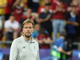 Klopp is wary of getting ahead of himself in regards to the title race. AFP
