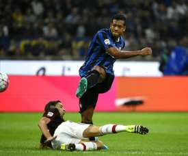 Inter Milans midfielder Fredy Guarin scores a goal during a Serie A football match against AC Milan at the San Siro Stadium in Milan on September 13, 2015
