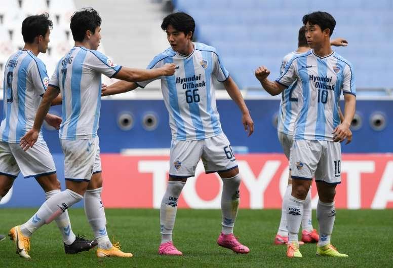 Yoon Bit-garam (R) scored twice as Ulsan qualified for the AFC CL last 16. AFP