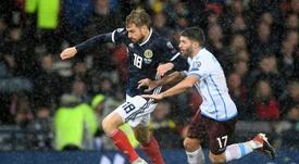 Scotland midfielder Stuart Armstrong has tested positive for coronavirus. AFP