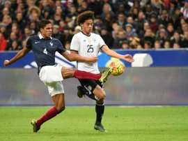 French defender Raphael Varane (L) vies with Germanys midfielder Leroy Sane during a friendly international football match between ahead of the Euro 2016, on November 13, 2015 at the Stade de France stadium in Saint-Denis, north of Paris